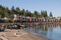 A wider shot of 4830 and twin 4954 as they lead their northbound intermodal through Steilacoom.