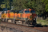 Resplendent in her H1 paint, BNSF C44-9W 976 leads a motley set of power northbound past the old mill storage tracks in Steilacoom.